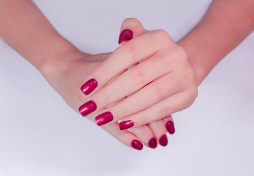 LADIES HANDS AFTER A MANICURE AND NAIL VARNISH